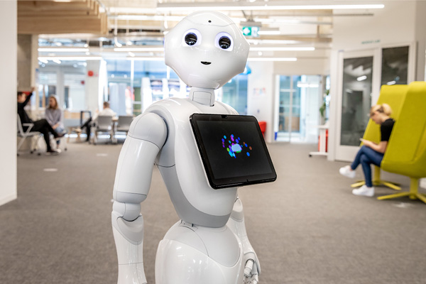 Pepper, the humanoid robot, poses for a picture in FCAD's The Catalyst research space at Ryerson University